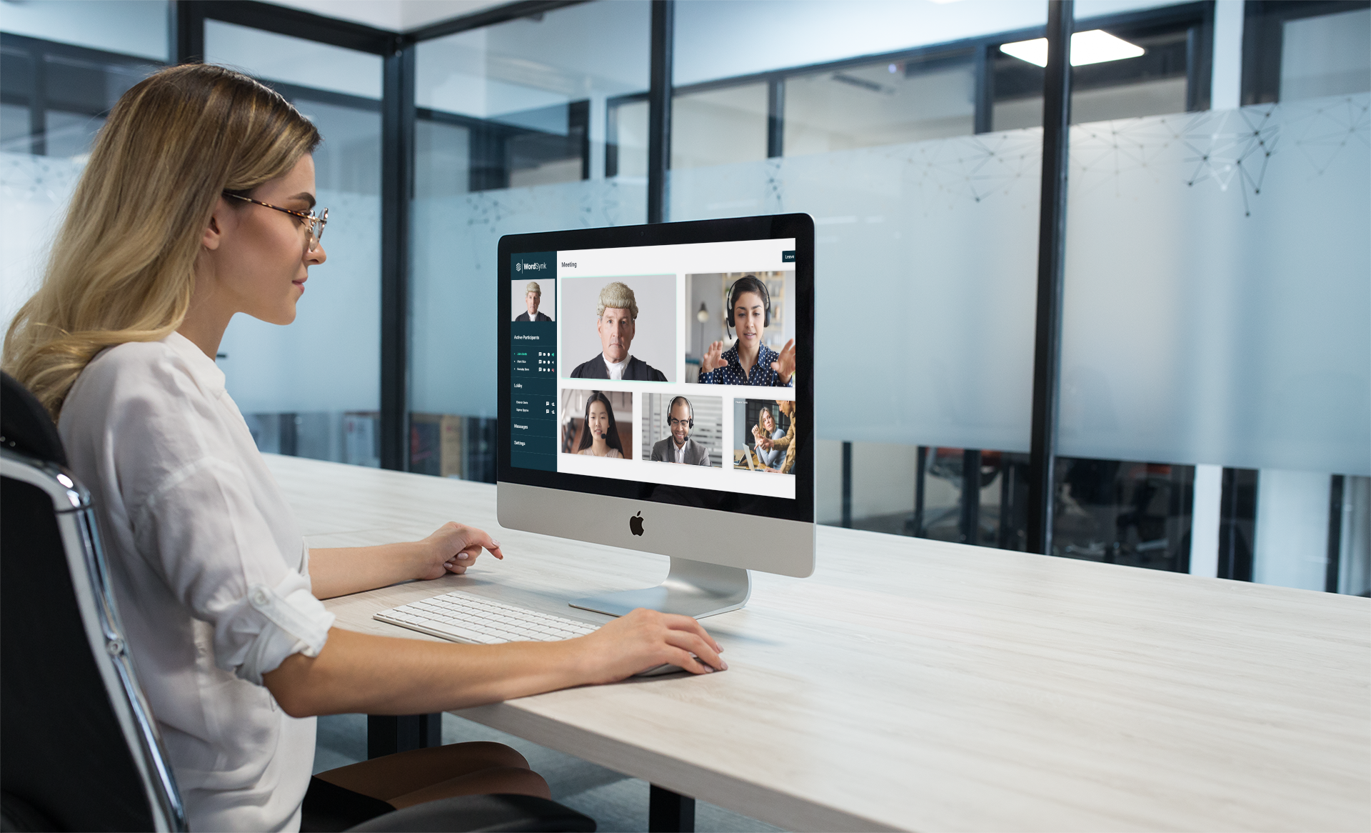 blonde-woman-using-an-imac-mockup-at-the-office-a20969